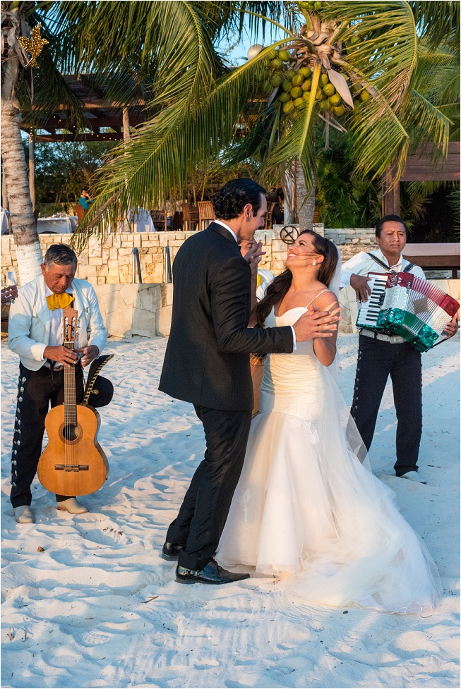 Bride and groom dancing with Mexican band