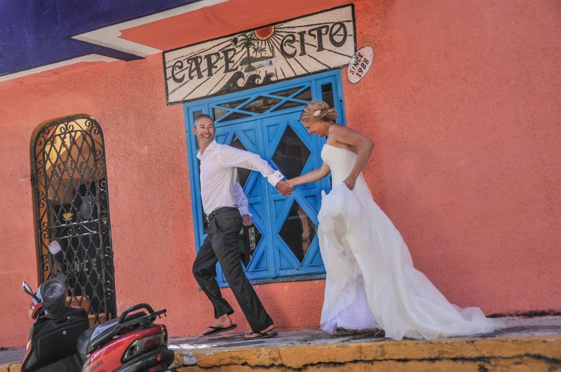 Bride and groom in front of Cafe Cito
