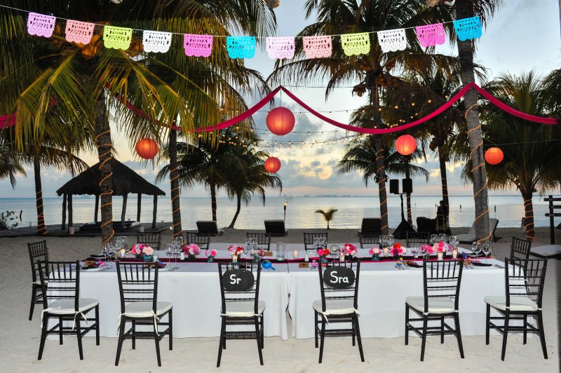 Reception table for bridal party overlooking ocean