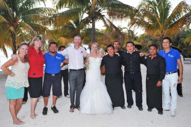 Bride and groom pose with SunHorse Wedding team
