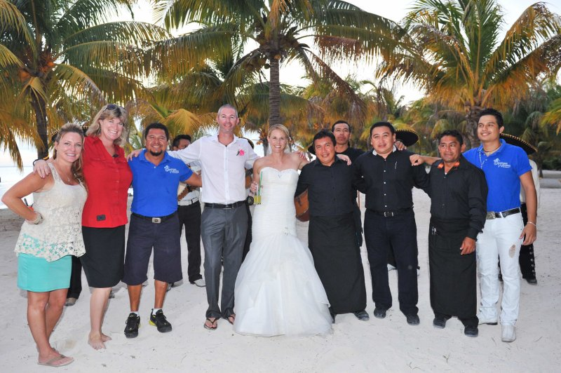 Bride and groom pose with SunHorse Wedding team