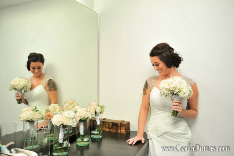 Photo of bride in front of a mirror