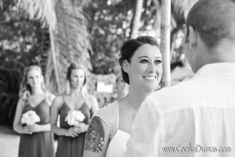 Black and white photo of bride smiling at groom