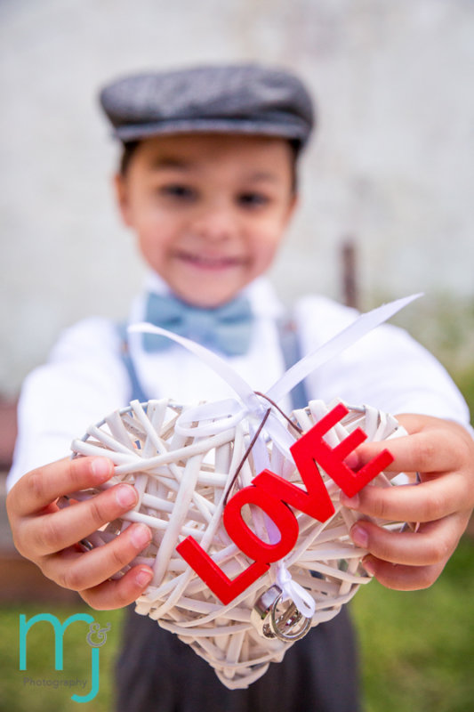 Mexican boy with heart that says love