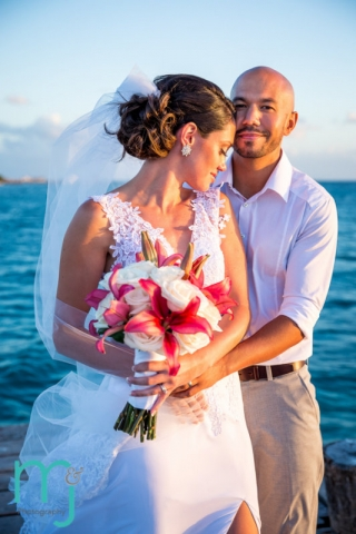 Bride and groom with ocean in background