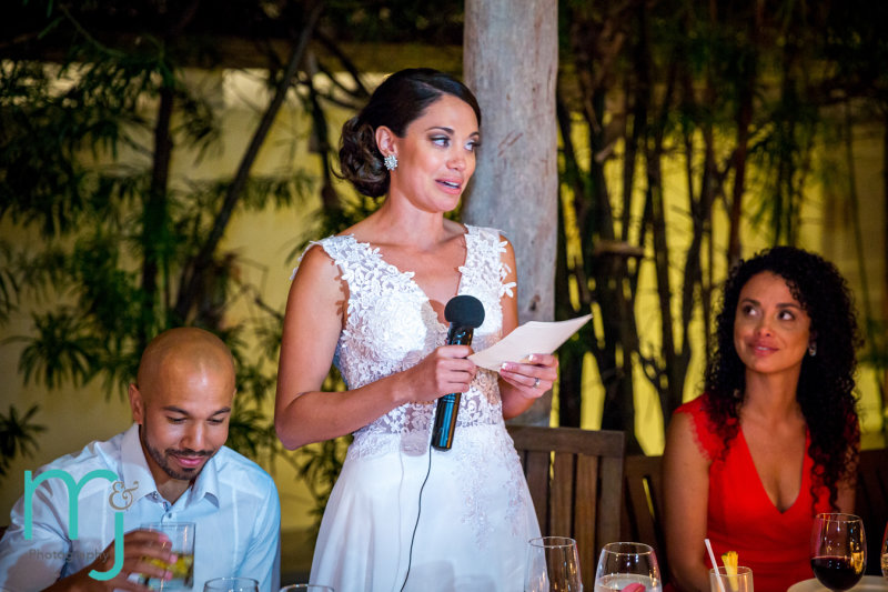 Bride speaking at reception