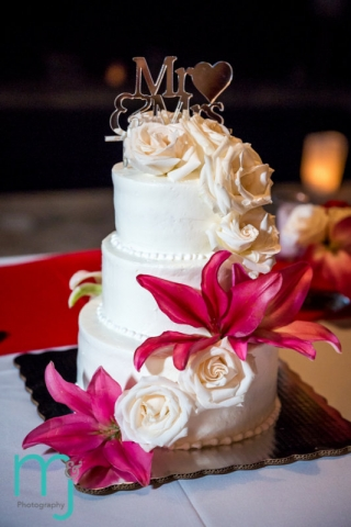 Wedding cake with red lilies and white roses