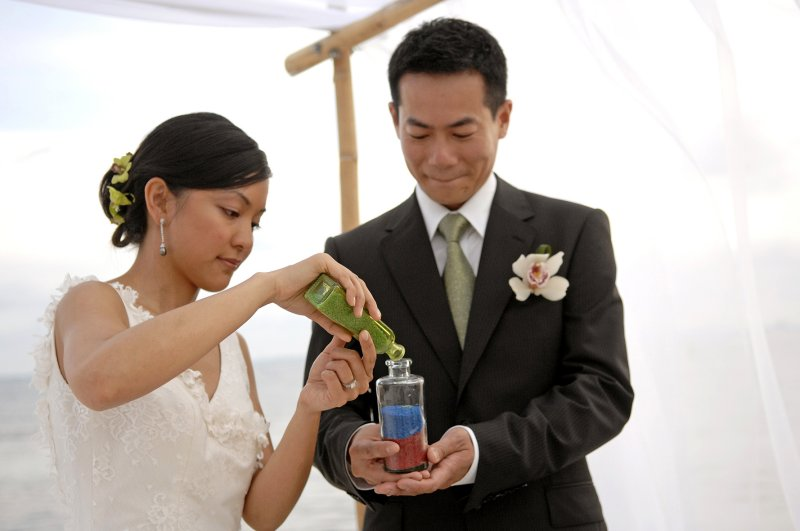 Bride and groom during sand ceremony