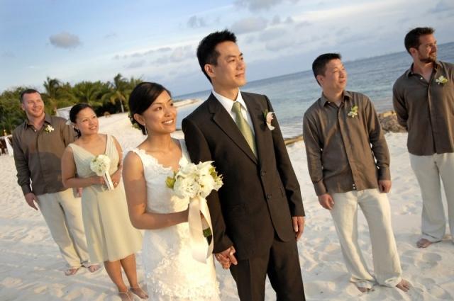 Bride walking down beach