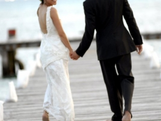 Bride and groom walking down dock