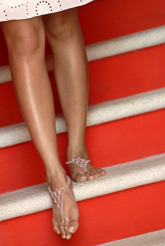 Bride wearing sandles on red steps