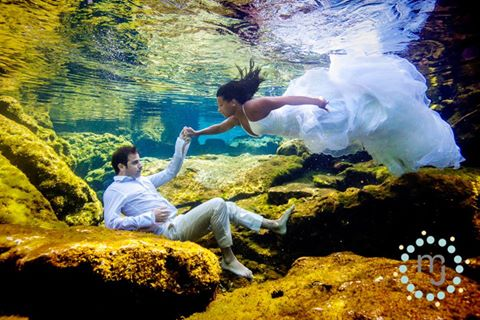 Underwater photography of bride and groom