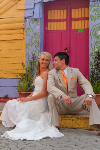 Bride and groom sitting on colorful porch
