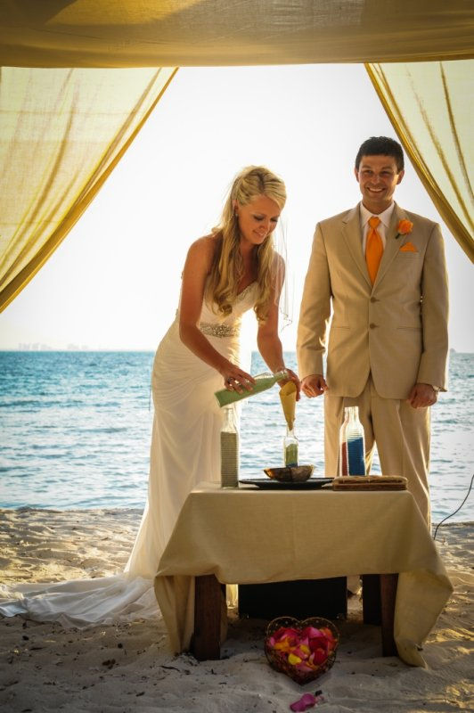 Bride and groom perform sand ceremony