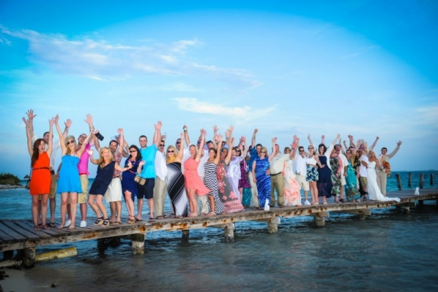 Wedding party celebrates on dock