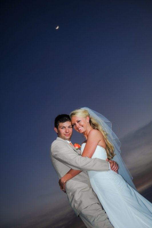Bride and groom portrait at night