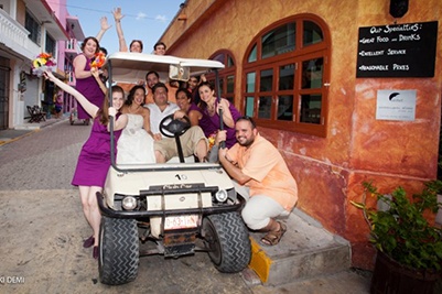Wedding party in golf cart