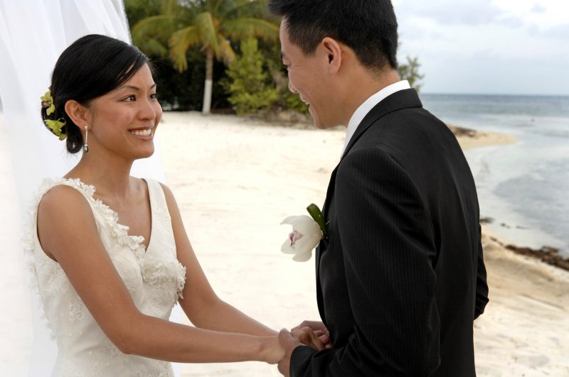 Couple Getting Married on Beach