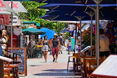 Couple walking downtown Isla Mujeres