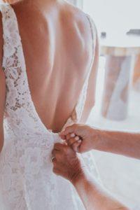 Zipping the wedding dress