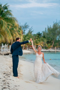 Couple on the beach in wedding attire