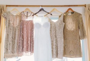 Sequin dresses hanging in a window